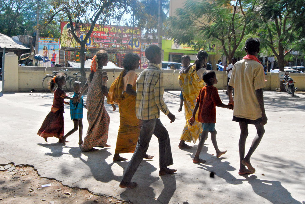 Families rescued from modern-day slavery walk into freedom, 2012.