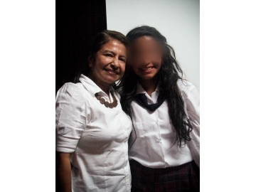 Delmi and Almita, pictured after a ceremony honoring IJM clients for their bravery in October 2012.