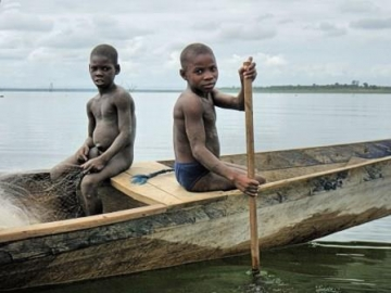 Children photographed fishing on Lake Volta, Ghana, in 2013
