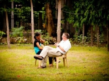 """IJM President Gary Haugen met Charito at an aftercare home where she has received care and counseling. """"Since I am loved,"""" she says, """"therefore I am able to love."""""""