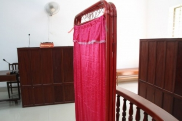 This curtain separated the retired colonel from the survivor's view as she testified.