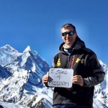 Nick Cienski #Stands4Freedom at 17,000 feet on Everest.
