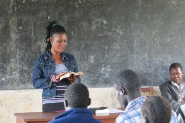 IJM Aftercare Specialist Dorothy Oriem speaks to IJM clients before the Krochet Kids' seminar on agriculture and raising livestock.