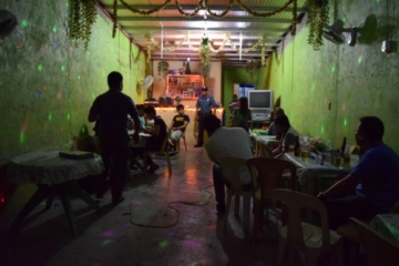 Inside the karaoke bar, after the young women were brought out and into safety.