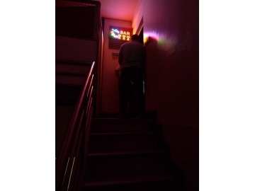 A staircase through the motel led to the rooftop bar where girls were being sold for sex.