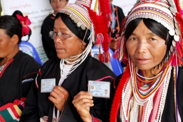 Many hill tribe people came dressed in their finest clothing to celebrate in Muang Na. These Akha women they have waited over 20 years for this moment.