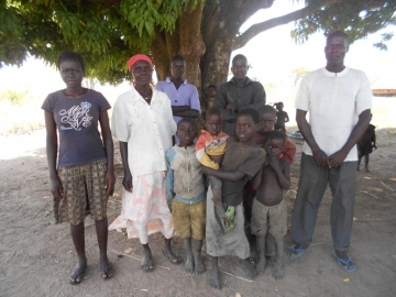 Catherine (second from left) with some of her children and grandchildren, all of whom rely on the widow for support.