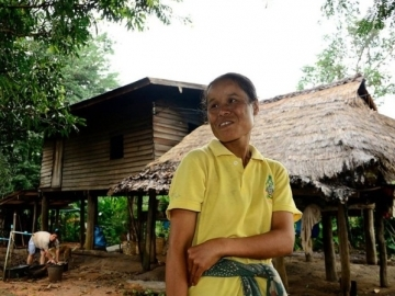Bua, pictured outside her home. Even though her parents and brother are registered Thai citizens, it took relentless advocacy and an arduous application process to prove hers. (Image: Compassion International)