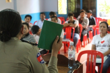 The chief officer of the Siem Reap anti-human trafficking police unit instructs the group on how to report crimes locally.