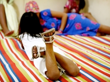 Raina, in the background, and her 4-year-old sister, rest at HerSpace, a safe shelter for trafficking survivors.