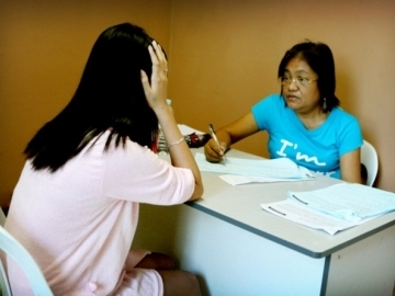 A government social worker interviews one of the trafficking survivors.