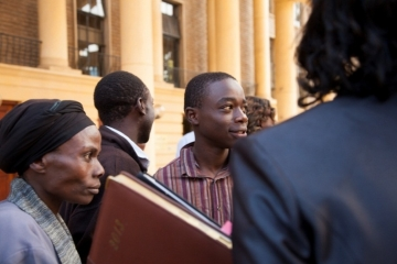 David and his mother talk with IJM Advocate Wamaitha outside the courthouse, after all the charges were dropped. David, 16, was one of the innocent boys rounded up in the random sweep of arrests.