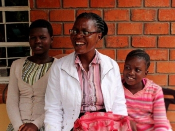 With IJM's help, Rhona was able to stand up to criminals who stole her daughters' inheritance. Today, the girls are safely in school and doing well.