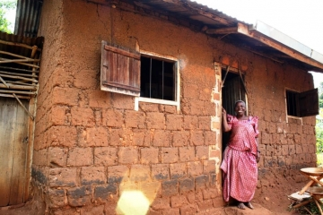 A man from Juliana's community tried to steal her small home and garden with violence until IJM and local police protected her.