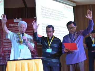 Leaders from the Catholic and Protestant councils offer a blessing over the gathering. From L-R: CBCP's Chairman Broderick S. Pabillo, National Director of PCEC Bishop Efraim M. Tendero and General Secretary of NCCP Reverend Rex RB Reyes, Jr.