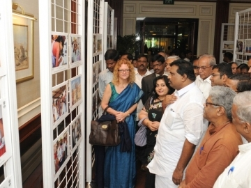 India's Minister of Labor and Employment, Kodikunnil Suresh, center, views a photo exhibit created by the International Labor Organization to depict the reality of forced labor slavery. [Image: Photo Division, Ministry of Information & Broadcasting, Government of India]