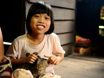 Mali, pictured on the day she received her Thai ID card. A process to prove her citizenship should have taken three to six months; instead, it took two and a half years. (Image: Compassion International)
