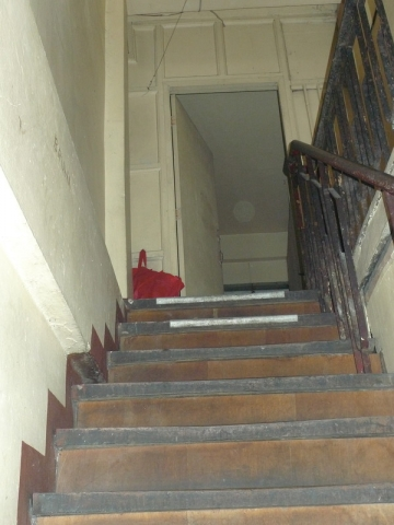 The stairs leading up to the third floor, where IJM and Philippine NBI found young women who were being sold for sex.