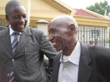 "IJM Kenya Director of Casework Benson Shamala, left, pictured with a jubilant Michael outside the court where he was finally declared innocent. Michael told IJM: ""You have protected me and I will never forget about you."""