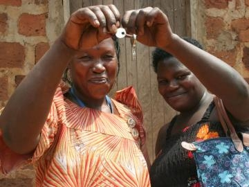 Namusisi and Rose proudly hold the keys to their new home