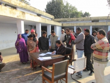 Government officials gathered the forced labor slaves in an office courtyard to grant official release certificates to 28 people, including children as young as 5.