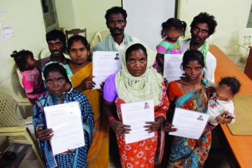 Rescued families hold up their release certificates.
