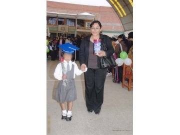 When Rocío graduated from kindergarten, IJM Bolivia staff were there to celebrate. Rocío, pictured here with Jeshika.