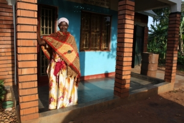 Sauda, pictured outside her home. Since her husband's death more than twenty years ago, she has been battling her stepson for rights to her home.