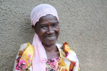 """Sauda, pictured on the day a Ugandan court overturned an earlier ruling and restored the widow to her rightful home. One IJM staff member said, """"I've never seen her smile like this before."""""""