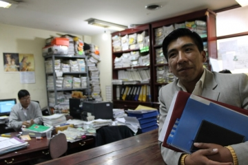 An IJM Bolivia paralegal stands in the prosecutor's office; he helped gather and prepare critical paperwork and records used as evidence in this case.