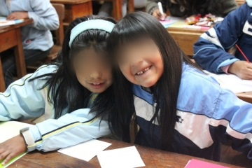 Wanda, pictured left, with her sister. Wanda says her favorite classes at school are Science and Physical Education.