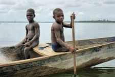 Children photographed fishing on Lake Volta, Ghana, in 2013