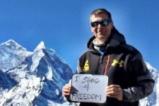 Nick Cienski #Stands4Freedom at 17,000 feet on Everest.