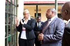 Debra Hobbs, a fellow with IJM Kampala, describes court improvements to Principal Judge Yorokamu Bamwine at the Open Court day on May 2.