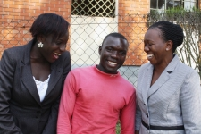 """Charles is flanked by IJM lawyer Diana and IJM aftercare specialist Lydia. Diana says: """"These arrests show that those who steal the property of the most vulnerable, will be punished. Because of these arrests, Charles now has hope that his land will be recovered."""""""