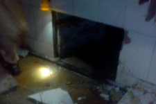 IJM staff and police searched the brothel for 45 minutes until they found this hidden crawlspace.