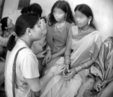 An IJM advocate speaks to Prema, center, on the night she is finally rescued from the violent brothel.
